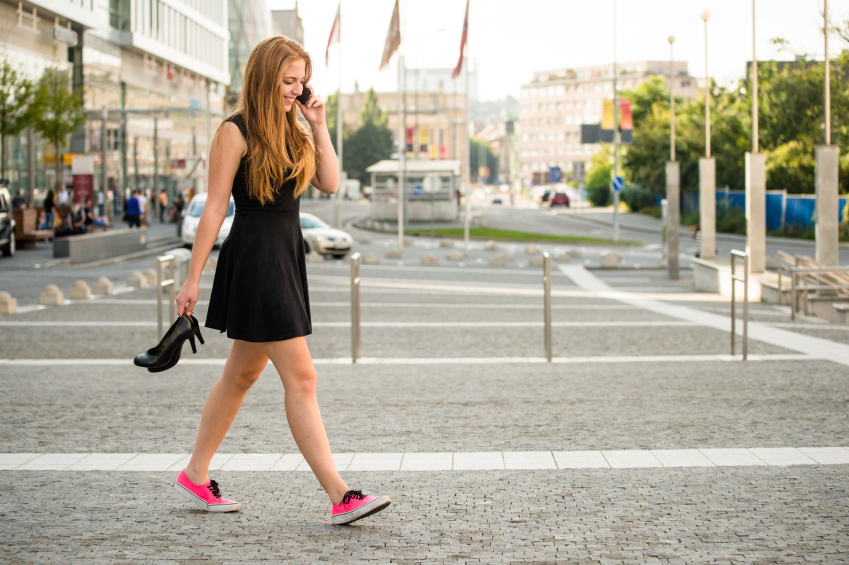 Teenager walking down street